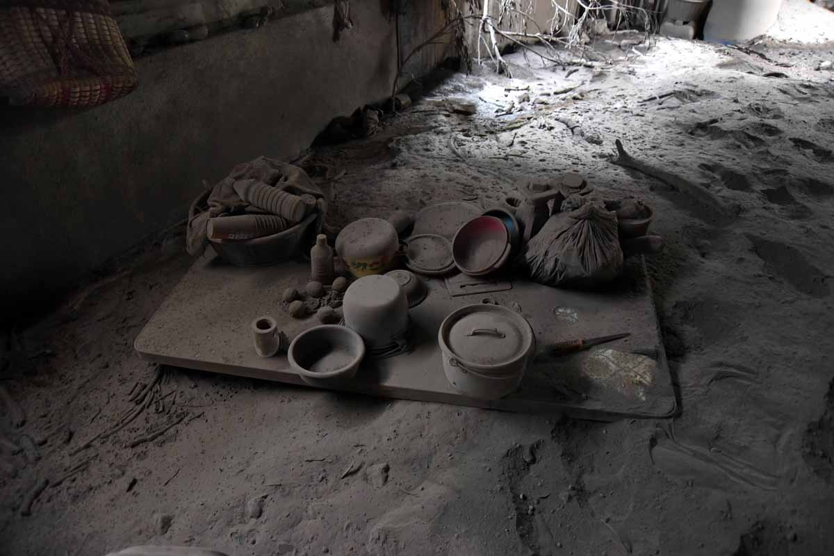 Inside view of abandoned houses in the ash-covered village of San Miguel Los Lotes, which was also flooded with hot mud that descended from the Fuego Volcano, in Escuintla department, about 35 km southwest of Guatemala City, on June 8, 2018.The threat of