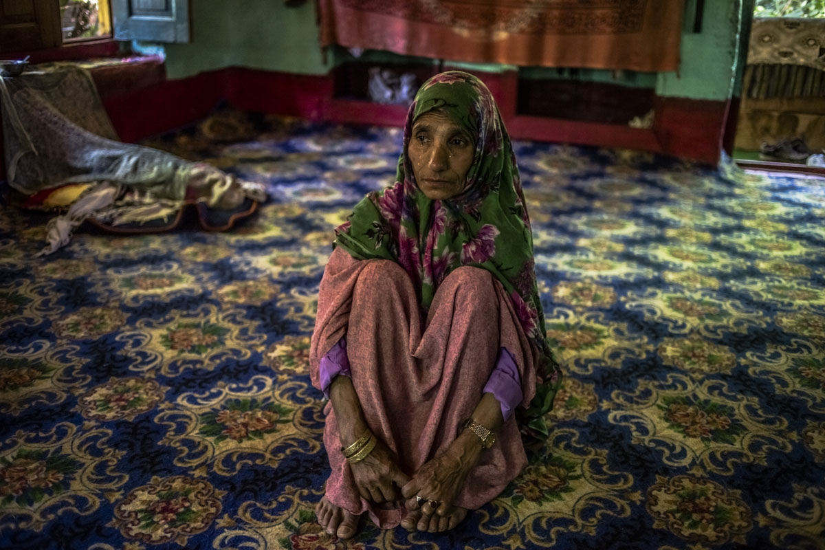 In this photo taken on June 29, 2016, Kashmiri mother Rahma Begum, who is unsure of her age, recounts the disappearance of her son Mir Ali, who went missing in 2003, one year after he married, at her home in Wantwoora Mohalla in Kandi in north Kashmir's K
