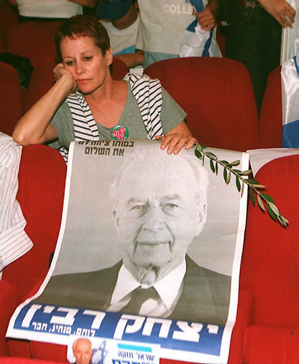 A Labor party supporter looks disappointed over a poster of slain former Israeli Prime Minister Yitzhak Rabin as figures between Likud party leader Benjamin Netanyahu and Labor incumbent Premier Shimon Peres continue to change late 29 May in Tel Aviv