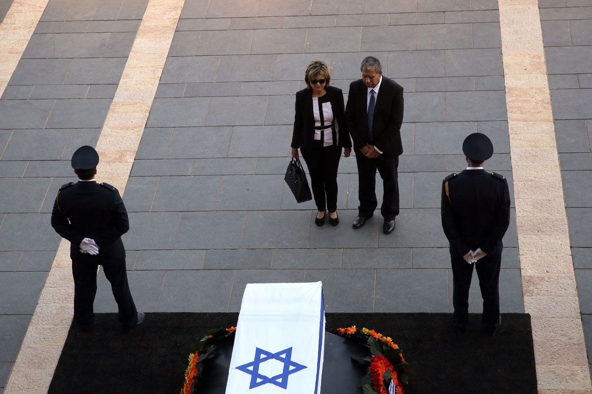 A member of parliament pays his respects next to the coffin of former Israeli president Shimon Peres at the Knesset, Israel's Parliament, in Jerusalem on September 29, 2016.