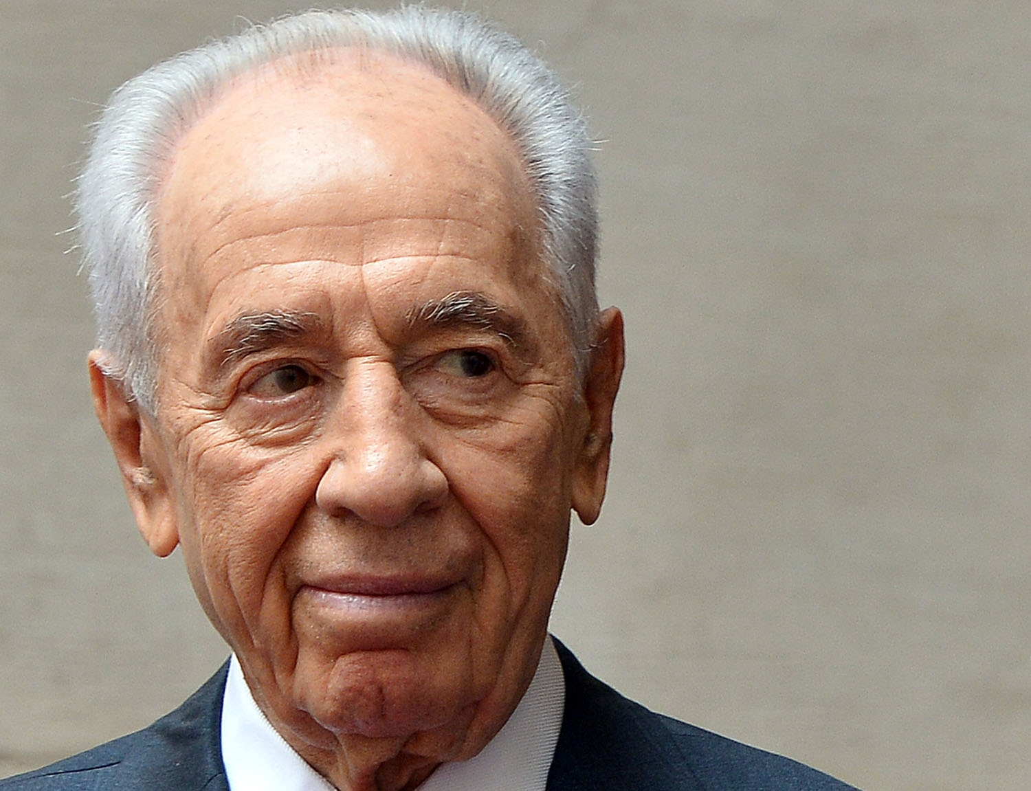 Israeli President Shimon Peres is pictured as he is welcomed by Italian Prime Minister at Chigi Palace in Rome on April 30, 2013