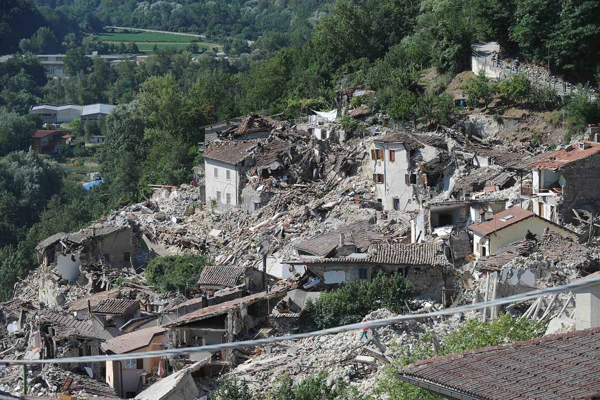 Damaged houses are pictured in Pescara del Tronto on August 25, 2016, a day after a 6.2-magnitude earthquake struck the region killing some 247 people.