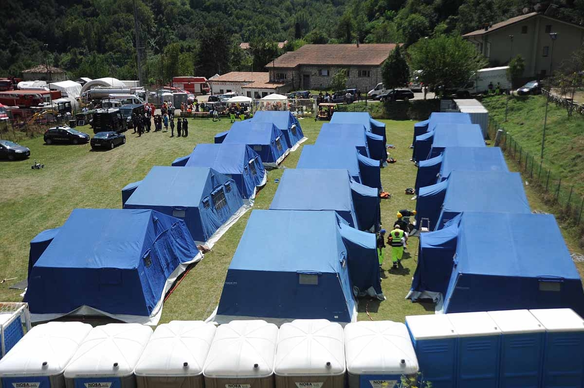 Tents of a temporary camp are installed at the central Italian village of Arquata del Tronto on August 25, 2016, a day after a 6.2-magnitude earthquake struck the region killing some 247 people.