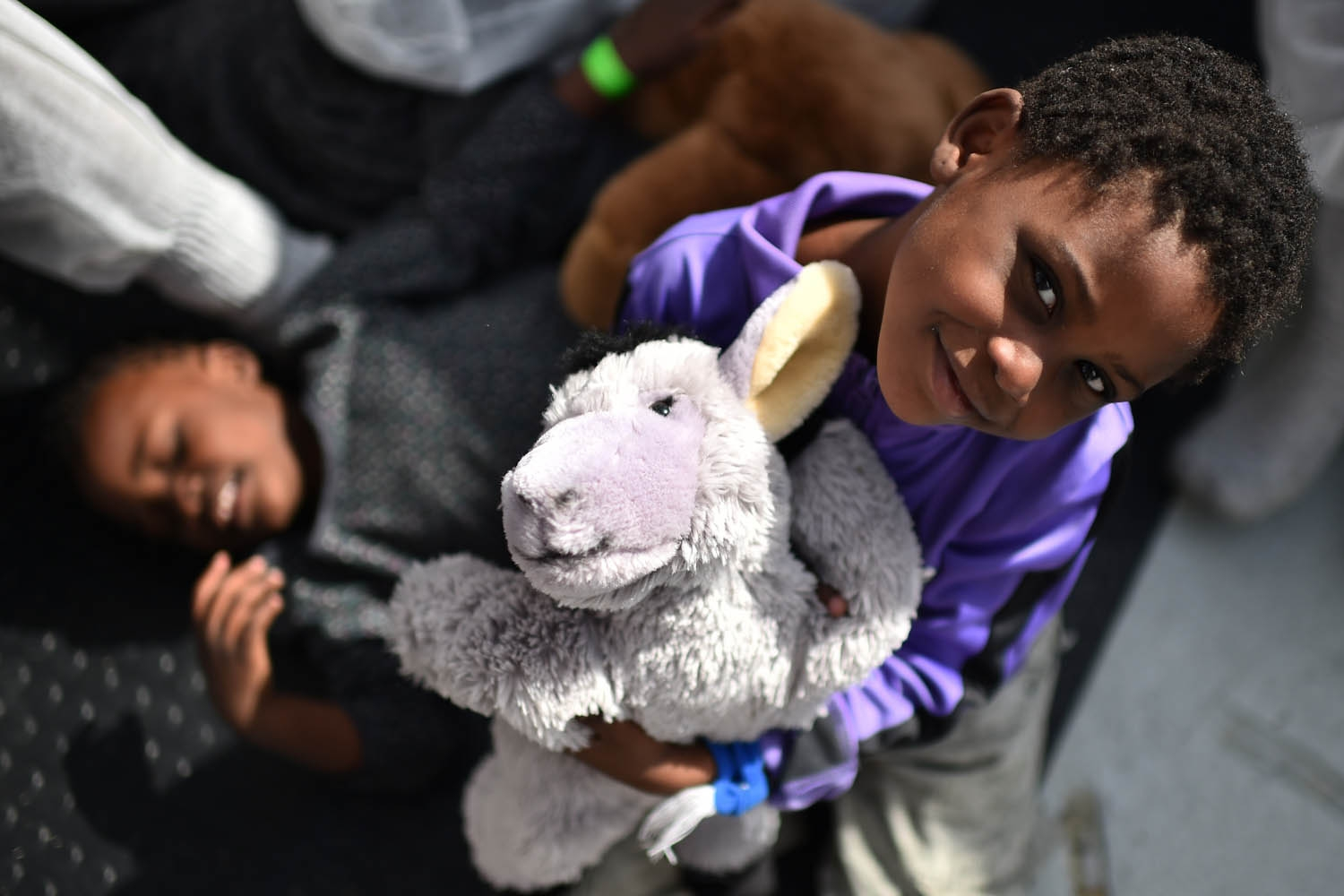 A child smiles during a distribution of meals aboard the rescue ship Aquarius, on May 25, 2016