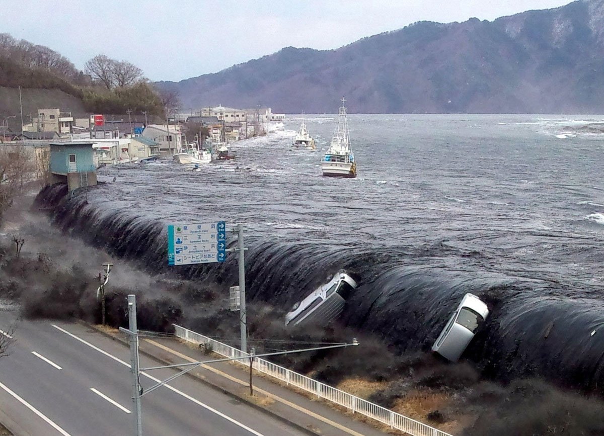 This picture taken by a Miyako City official on March 11, 2011 and released on March 18, 2011 shows a tsunami breeching an embankment and flowing into the city of Miyako in Iwate prefecture shortly after a 9.0 magnitude earthquake hit the region of northe