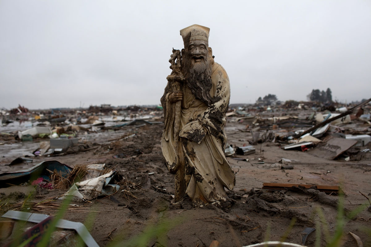 A statue stands in a rice field devastated by the March 11 tsunami in Natori in Miyagi prefecture on April 23, 2011.