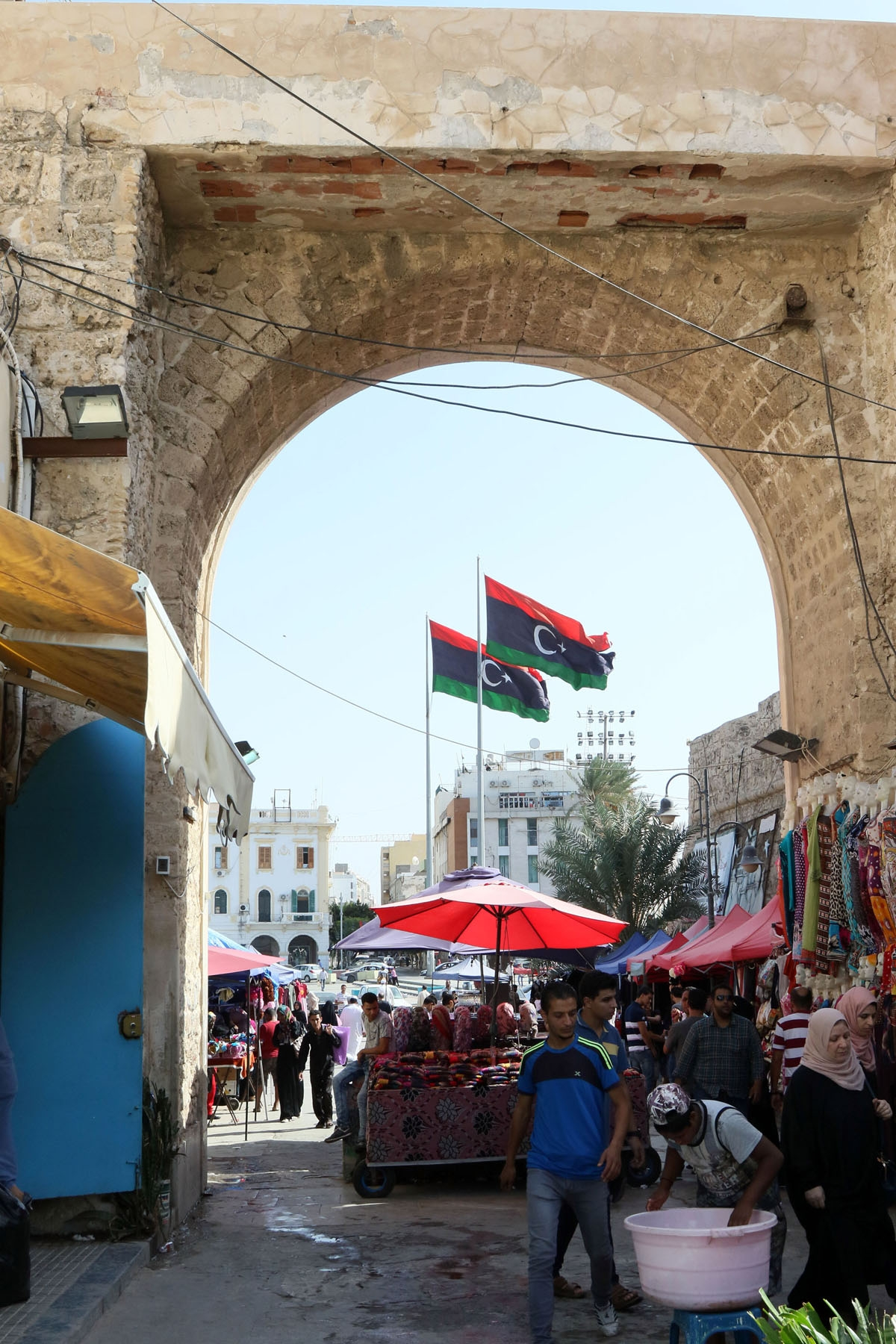 Libyans shop at a market on Martyrs' square in the Libyan capital Tripoli on October 18, 2016.