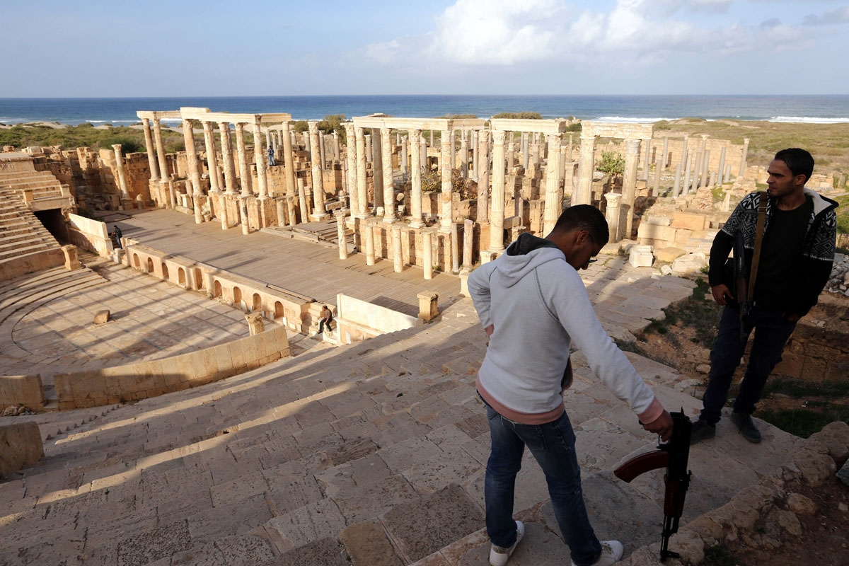 Armed men guard the amphitheatre in the ancient Roman city of Leptis Magna in al-Khums, 130 kms east of the Libyan capital Tripoli, on December 18, 2016.