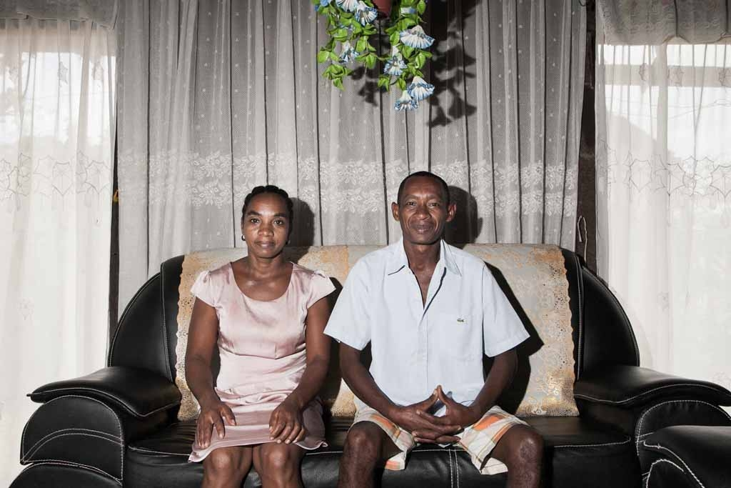 Vanilla producer 43-year old Patrick Razafiarivo poses with his wife Lalao in their living room on May 26, 2016 in the municipality of Ambomalaza, Sambava, Madagascar.