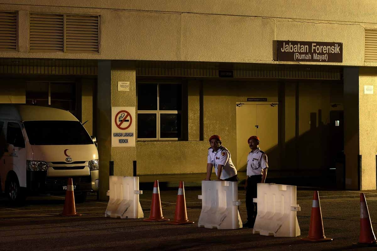 Malaysian private security guards stand guard outside the Forensics department at Putrajaya Hospital in Putrajaya on February 14, 2017, where the body of a North Korean man suspected to be Kim Jong-Nam, half-brother of North Korean leader Kim Jong-Un is b