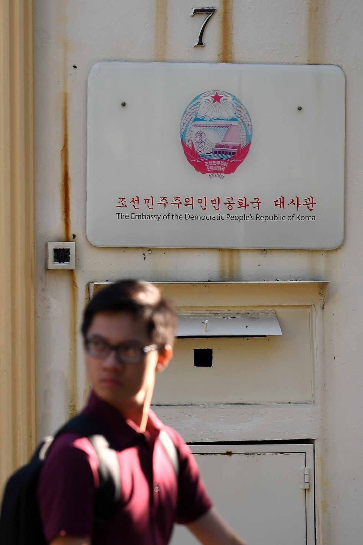 A man walks past the North Korean embassy in Kuala Lumpur on February 15, 2017, a day after it was reported that a North Korean man suspected to be Kim Jong-Nam, half-brother of North Korean leader Kim Jong-Un, had been assasinated.