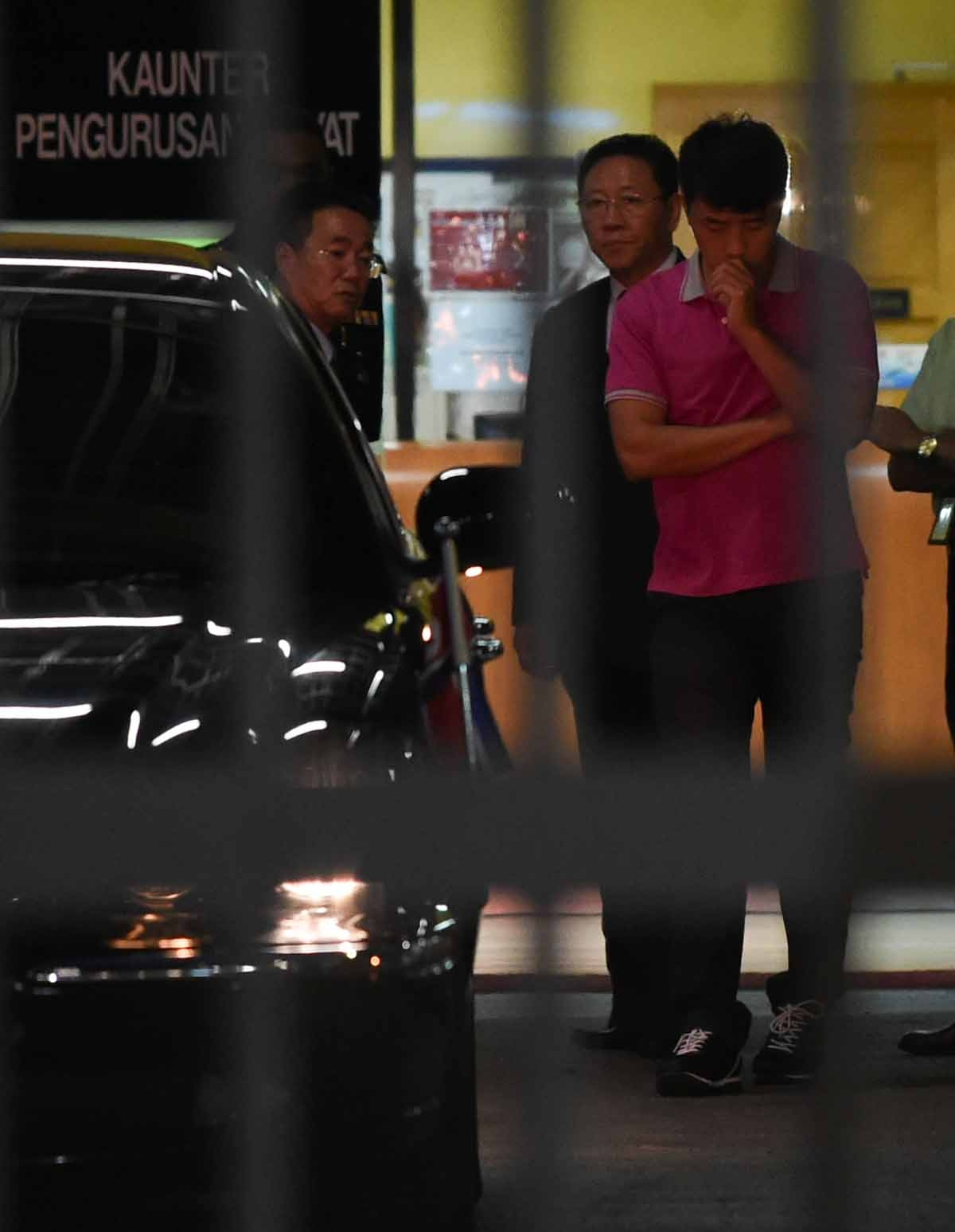 North Korean embassy officials leave the Forensic department where the body of a North Korean man suspected to be Kim Jong-Nam, half-brother of North Korean leader Kim Jong-Un, is bieng kept at the Hospital Kuala Lumpur in Kuala Lumpur on February 15, 201