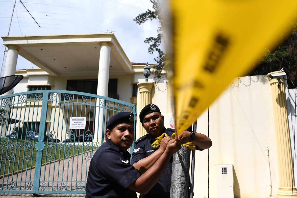 Malaysian police cordon off the area outside the North Korean Embassy in Kuala Lumpur on February 23, 2017 ahead of a protest by the United Malays National Organization (UMNO) Youth activists.