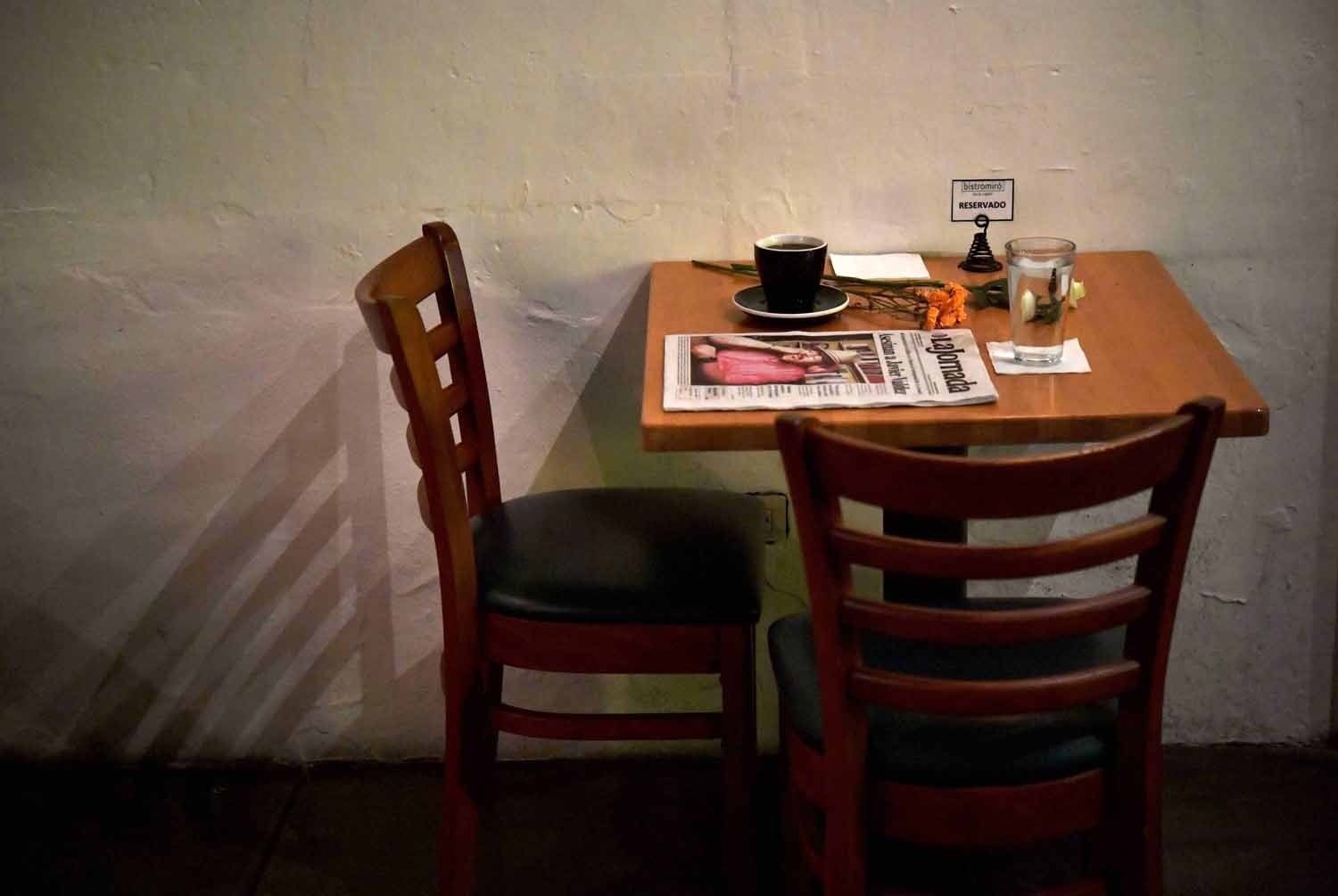 A makeshift altar with a cup of coffee, water glass and newspaper headlining the story of slain Mexican journalist Javier Valdez is pictured in a cafe previously frequented by Valdez in Culiacan, Sinaloa State, Mexico on May 16, 2017.