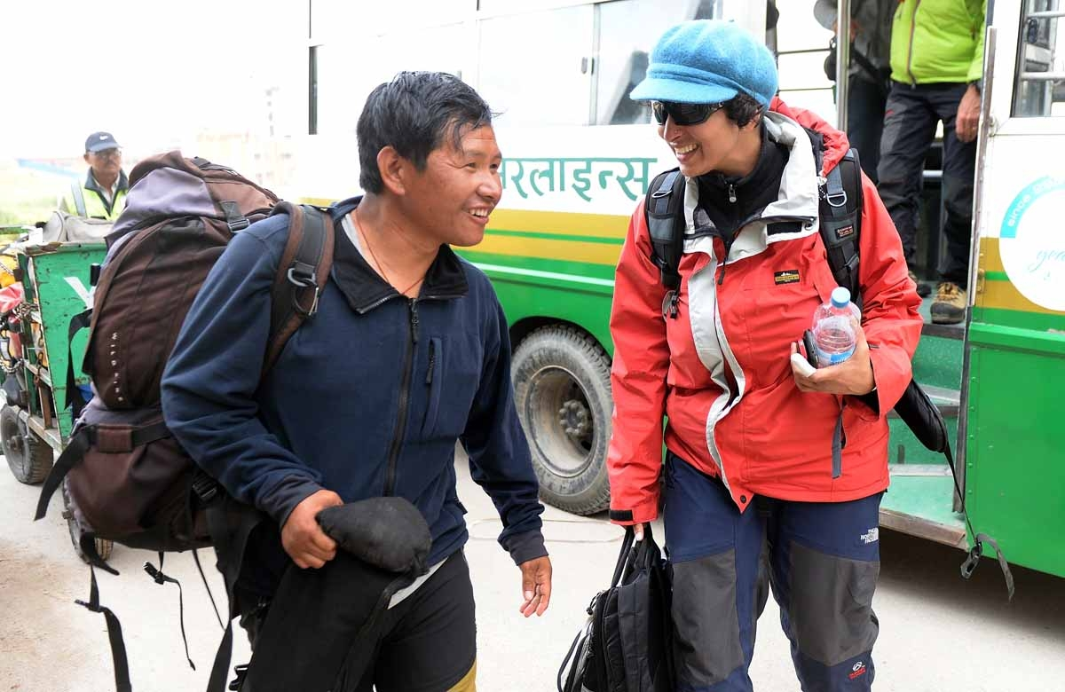 Agence France-Presse (AFP) Nepal Bureau Chief Ammu Kannampilly (R) talks with Pasang Sherpa on her arrival from Everest base camp in Kathmandu on April 29, 2015.
