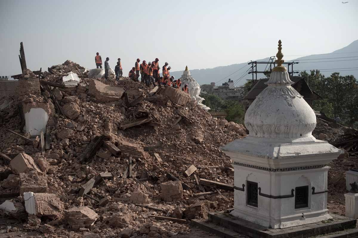 Nepalese Armed Police Force clear rubble at the Narayan temple in Kathmandu on May 1, 2015, following a 7.8 magnitude earthquake which struck the Himalayan nation on April 25.