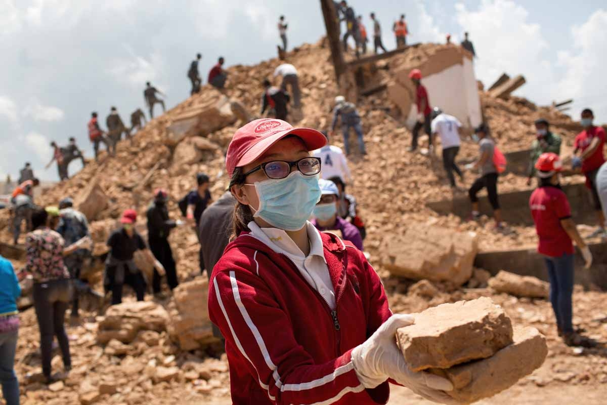 Nepalese civilians and police personnel clear rubble at the Narayan temple in Kathmandu on May 2, 2015, one week after a 7.8 magnitude earthquake which struck the Himalayan nation on April 25.