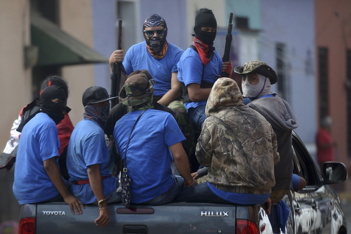 Paramilitaries are seen on trucks at Monimbo neighborhood in Masaya, Nicaragua, on July 18, 2018, following clashes with anti-government demonstrators.