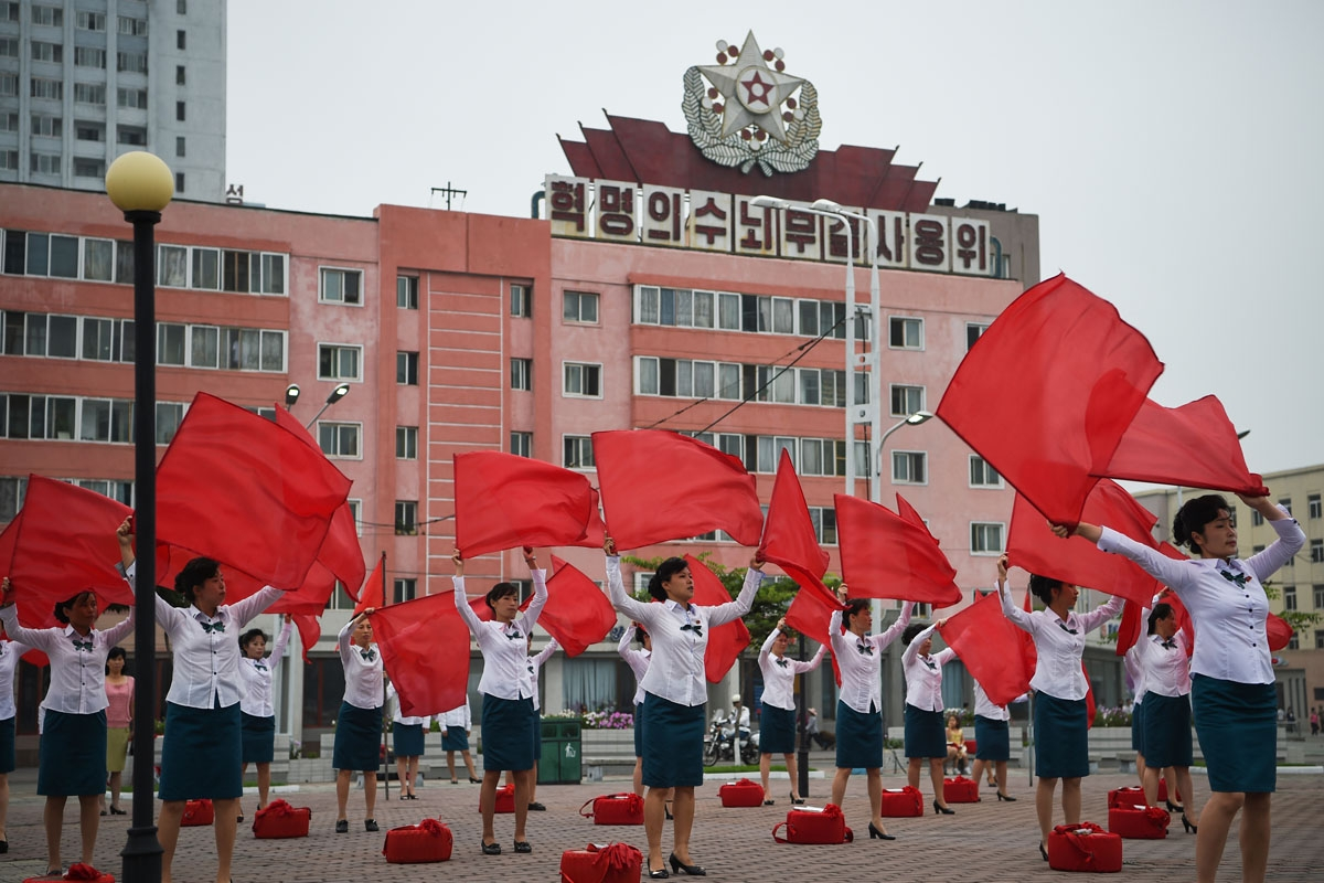 Members of a local propaganda troupe perform in a public square as part of a 200 day campaign aimed at kickstarting a new economic plan, in Pyongyang on July 10, 2016