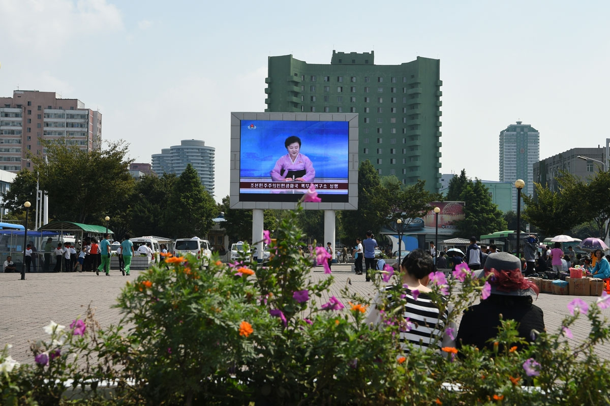 A big screen in front of Pyongyang railway station shows television presenter Ri Chun-Hee officially announcing that the country successfully tested a nuclear warhead earlier in the day on September 9, 2016