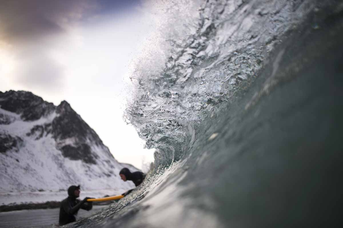 Norwegian surfer Tommy Olsen is seen in the water as he gives a surfing lesson to beginners in Flakstad, near Unstad along the northern Atlantic Ocean on March 9, 2017, where the water temperatures is at five degrees centigrade and the air temperature is