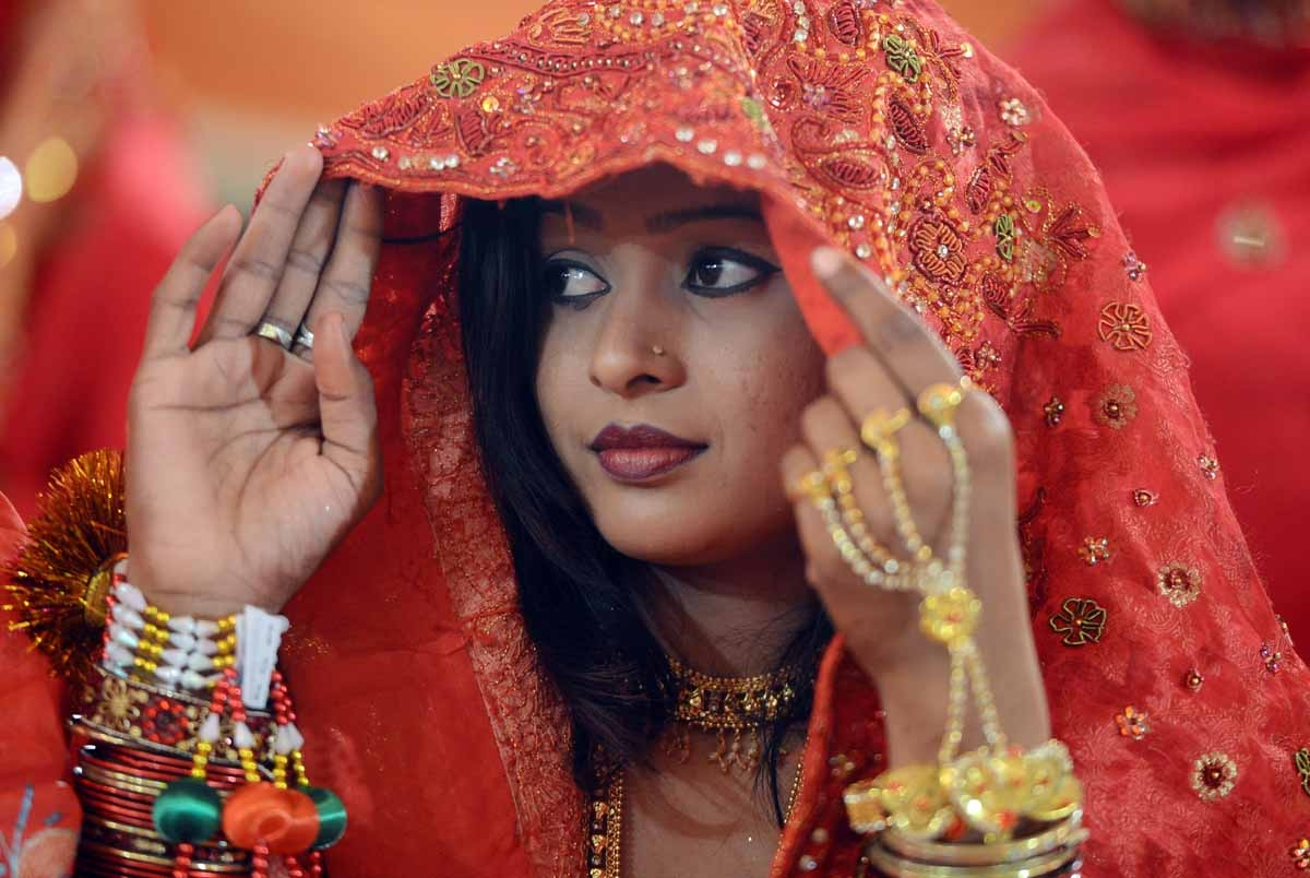 A Pakistani bride looks on during a mass marriage ceremony in Karachi late March 26, 2013.