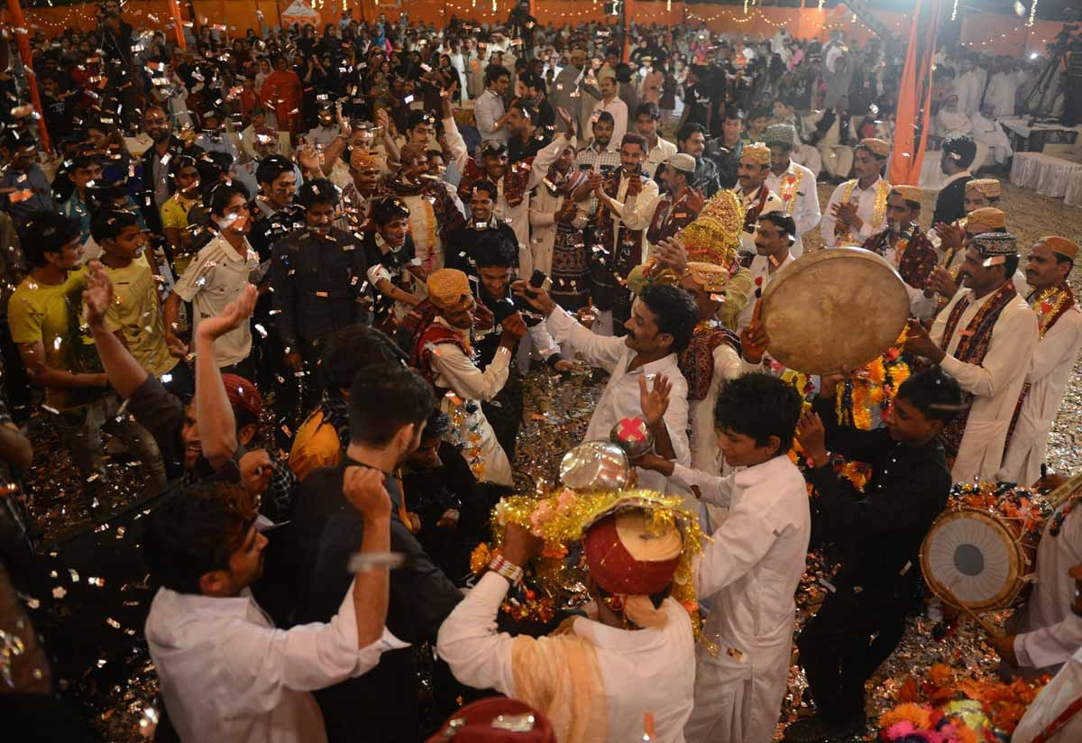 Pakistani grooms celebrate during a mass marriage ceremony in Karachi late March 26, 2013.