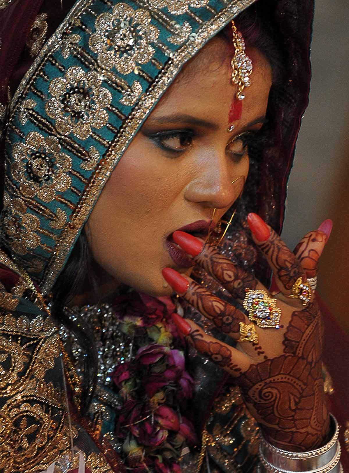A Pakistani Hindu bride participates in a mass marriage ceremony in Karachi on November 30, 2013.