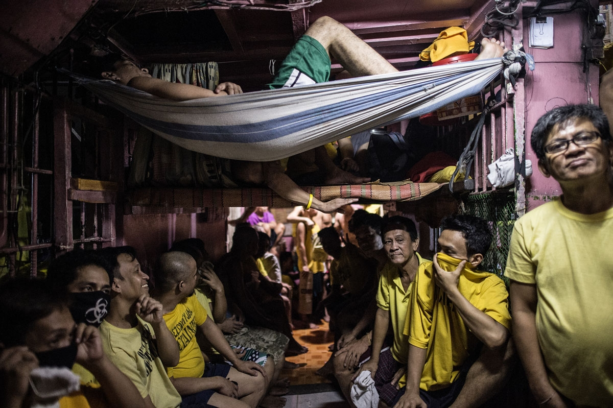 Inmates rest in their sleeping quarters inside the Quezon City jail at night in Manila in this picture taken on July 18, 2016.