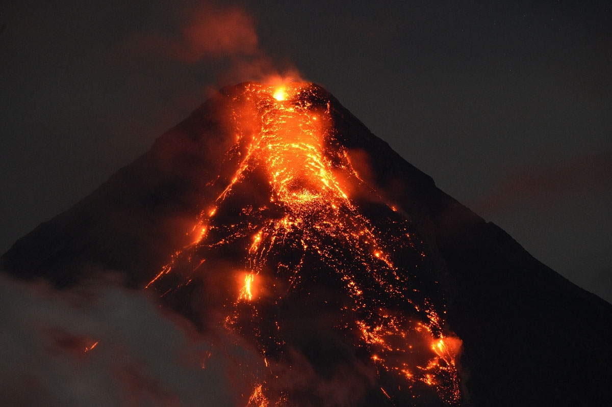 Lave flows from Mayon volcano at it continues to erupt as seen from Legazpi in Albay province, south of Manila, on January 25, 2018.