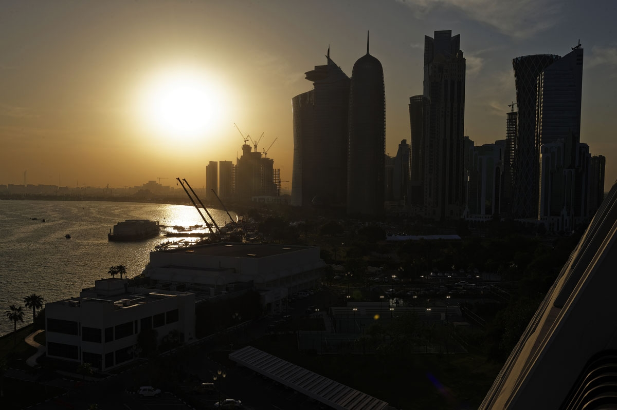 The sun sets over the Qatari capital Doha on February 7, 2015