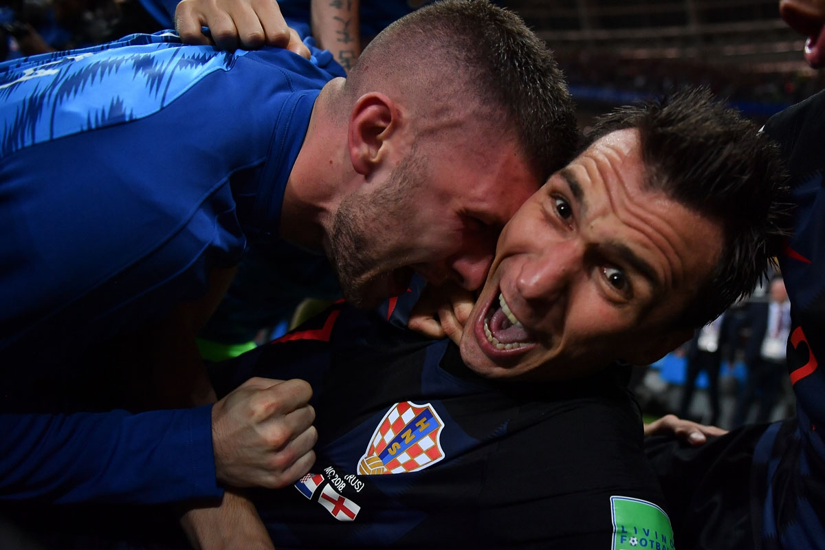 Croatia's forward Mario Mandzukic (R) celebrates with teammates after scoring his team's second goal during the Russia 2018 World Cup semi-final football match between Croatia and England at the Luzhniki Stadium in Moscow on July 11, 2018