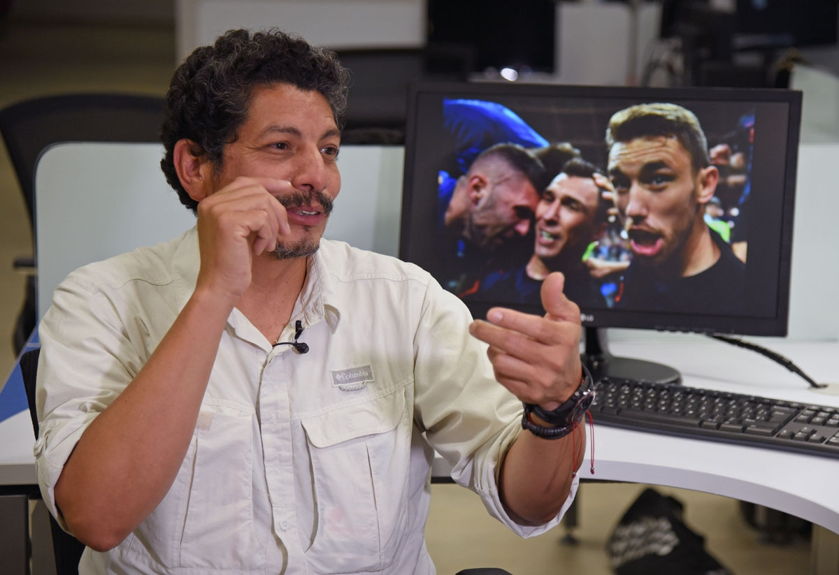 AFP photographer Yuri Cortez, who unwittingly became part of the celebrations of Croatia in their World Cup semi-final match against England, gestures during an interview with AFP in Mexico City on July 12, 2018.