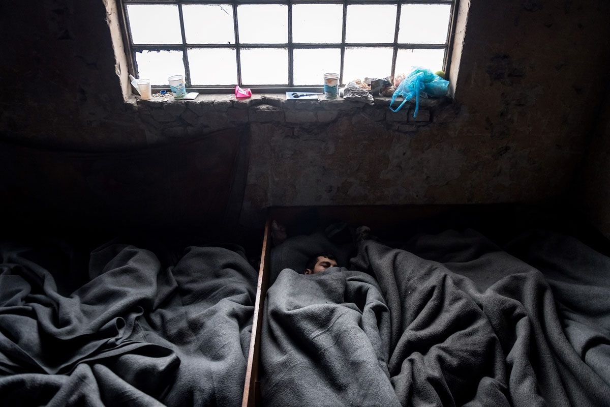 Migrants sleep inside a derelict warehouses near Belgrade's main railway station on January 17, 2017, with temperatures bellow zero Celsius.