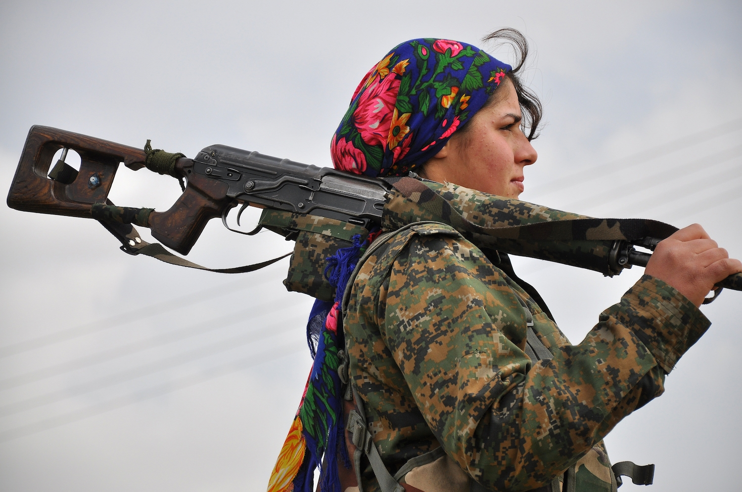 A Kurdish female fighter of the Women's Protection Units (YPJ) looks on at a training camp in al-Qahtaniyah, near the Syrian-Turkish border on February 13, 2015. Syrian Kurdish forces have recaptured more than a third of the villages around Kobane from th