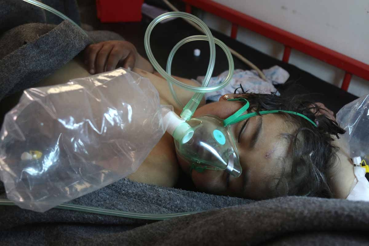 A Syrian child receives treatment at a small hospital in the town of Maaret al-Noman following a suspected toxic gas attack in Khan Sheikhun, a nearby rebel-held town in Syria's northwestern Idlib province, on April 4, 2017.