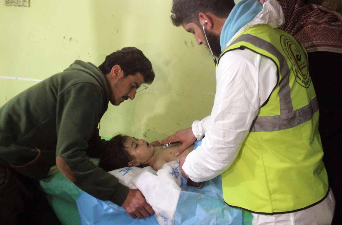 An unconscious Syrian child receives treatment at a hospital in Khan Sheikhun, a rebel-held town in the northwestern Syrian Idlib province, following a suspected toxic gas attack on April 4, 2017.