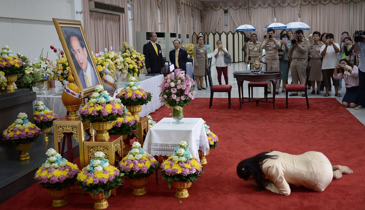 Treading softly in thailand correspondent ousted thai prime minister yingluck shinawatra bows to a portrait of thai king bhumibol adulyadej as izmirmasajfo