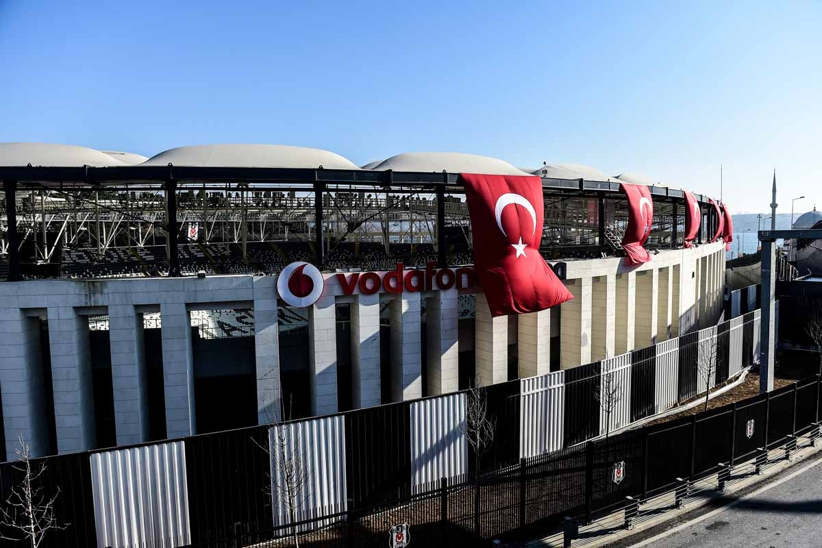 Turkish flags decorate the Vodafone Arena football stadium in Istanbul on December 11, 2016, a day after twin bombings near the home stadium of Besiktas football club.