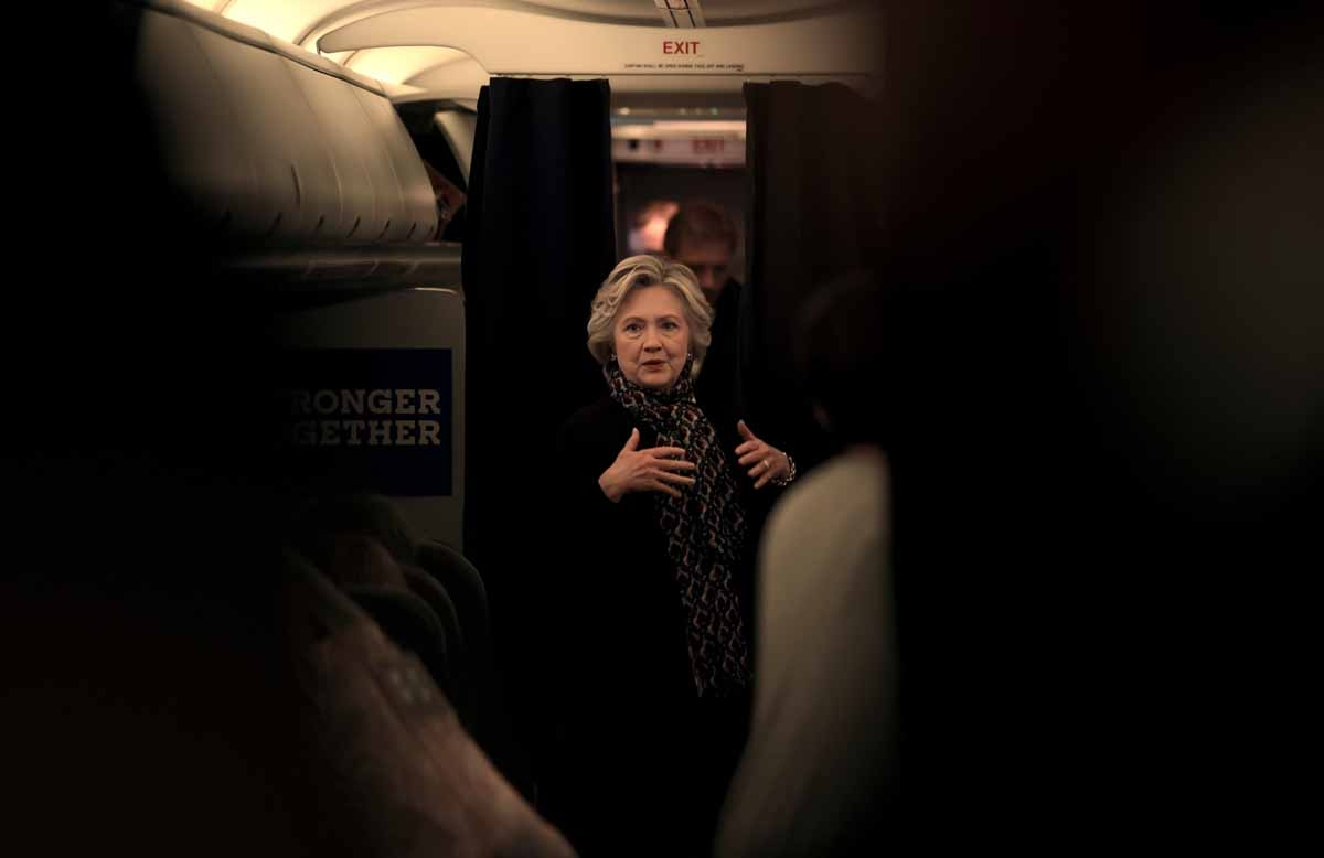 US Democratic presidential nominee Hillary Clinton on her aircraft enroute to the debate at Washington University in St. Louis, Missouri October 9, 2016.