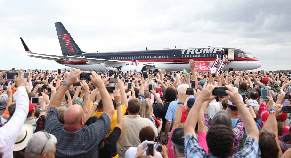 Republican presidential nominee Donald Trump arrives for a campaign event at Lakeland Linder Regional Airport in Lakeland, Florida on October 12, 2016.