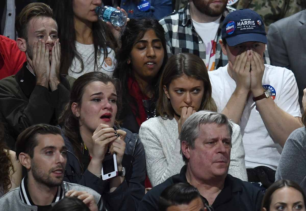 Supporters of Democratic presidential nominee Hillary Clinton react during election night at the Jacob K. Javits Convention Center in New York on November 8, 2016.