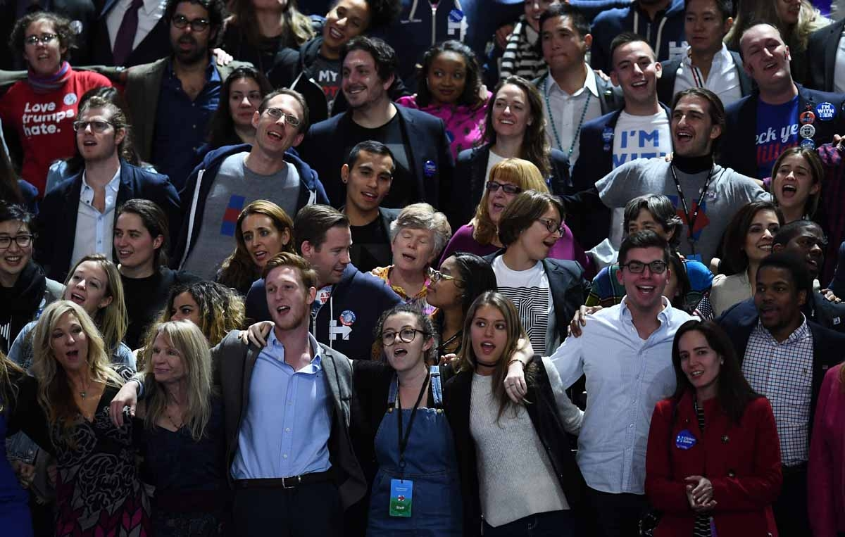 Supporters of Democratic presidential nominee Hillary Clinton sing during election night at the Jacob K. Javits Convention Center in New York on November 8, 2016.