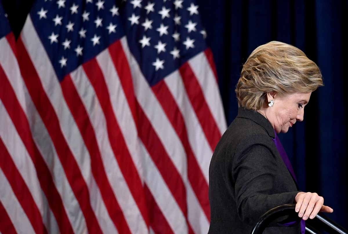 US Democratic presidential candidate Hillary Clinton steps down a staircase after making a concession speech following her defeat to Republican President-elect Donald Trump, in New York on November 9, 2016.