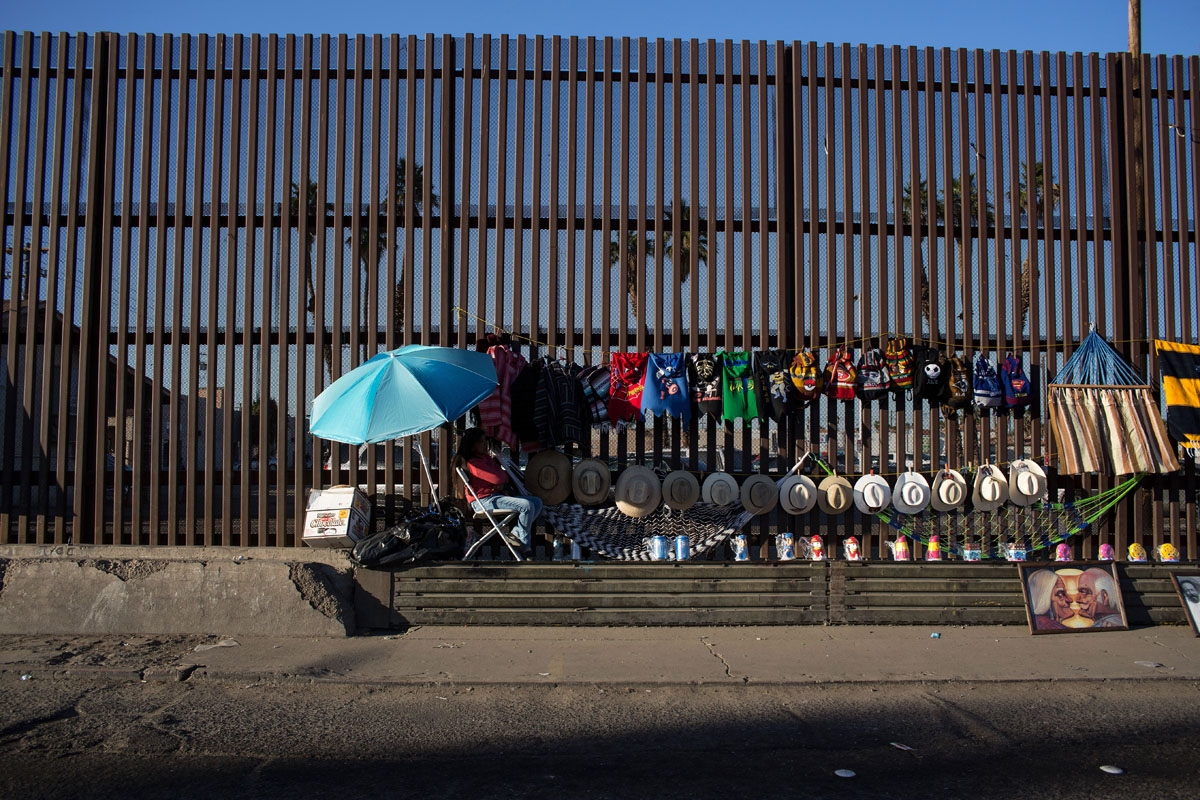 Street vendors use the border fence as a shelf to display their items on the US/Mexico border in Mexicali on February 14, 2017, northwestern Mexico.