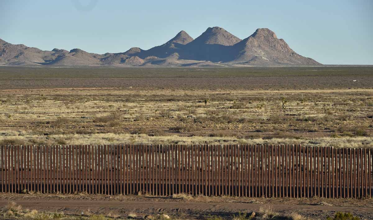View of the metal fence between US and Mexico taken in Puerto Palomas, Chihuahua state on February 19, 2017.
