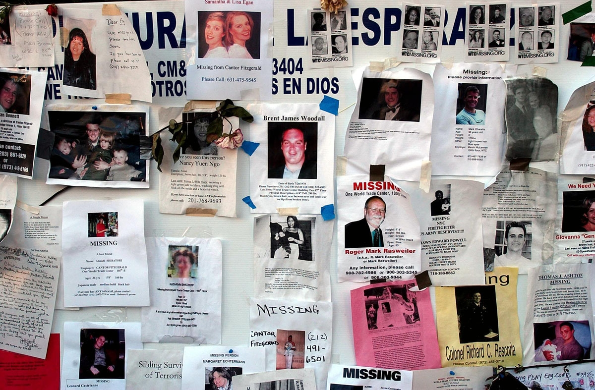 Posters for victims of the World Trade Center are displayed near a memorial for victims of the World Trade Center attack 19 September 2001