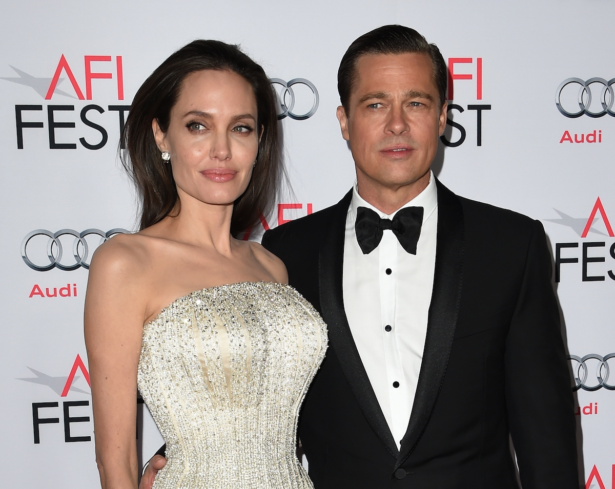 Writer-director-producer-actress Angelina Jolie Pitt (L) and actor-producer Brad Pitt arrive for the opening night gala premiere of Universal Pictures' 'By the Sea' during AFI FEST 2015 presented by Audi at the TCL Chinese Theatre in Hollywood, California