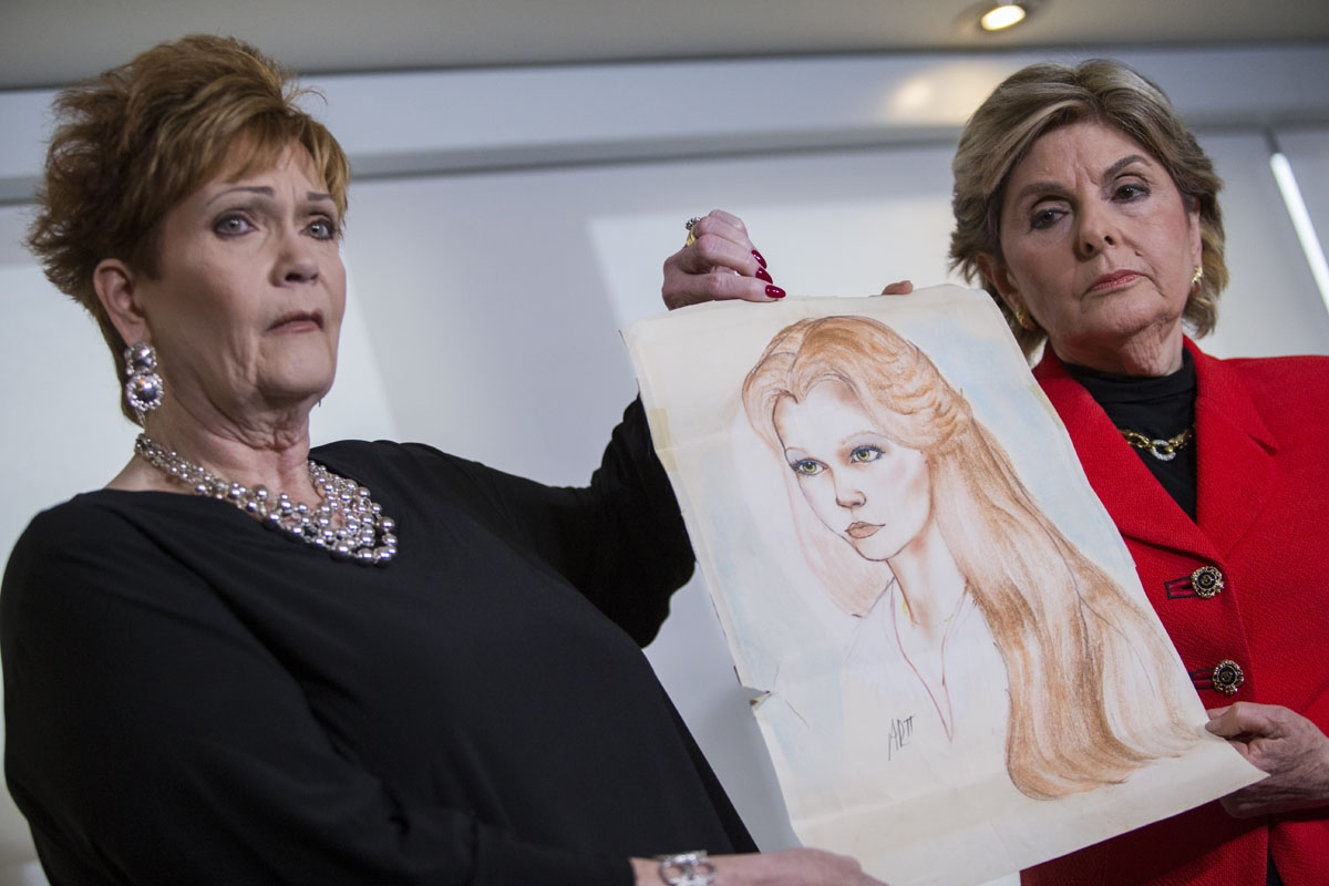 Attorney Gloria Allred (R) and Beverly Young Nelson hold up a drawing of Nelson when she was younger during a press conference on November 13, 2017, in New York, alledging that Roy Moore sexually assaulted Nelson when she was a minor in Alabama without he