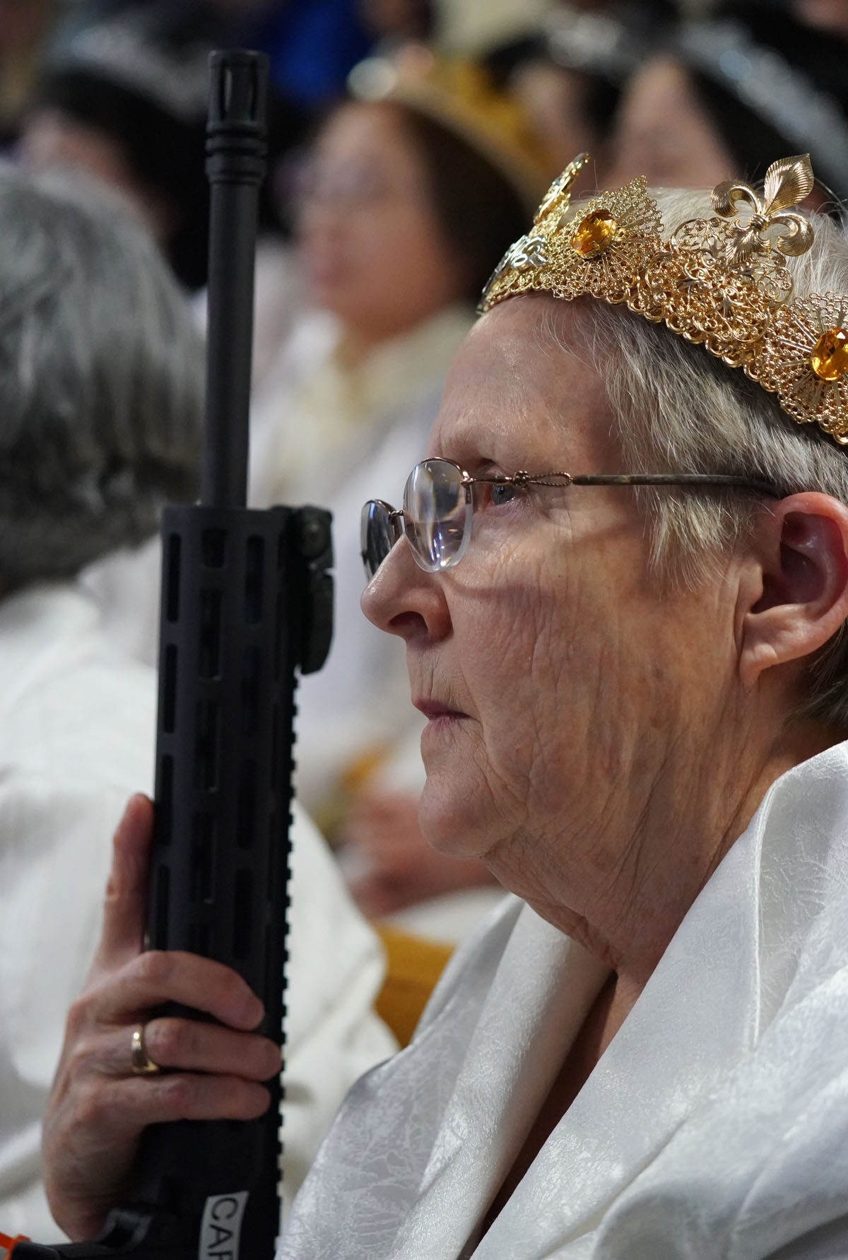 Worshippers at World Peace and Unification Sanctuary hold weapons during their service February 28, 2018 in Newfoundland, Pennsylvania.